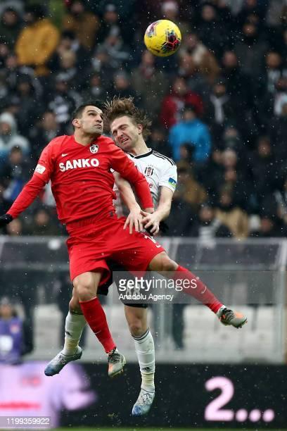 Caner Erkin of Besiktas in action against Muhammet Demir of Gaziantep FK during the Turkish Super Lig soccer match between Besiktas and Gaziantep FK...