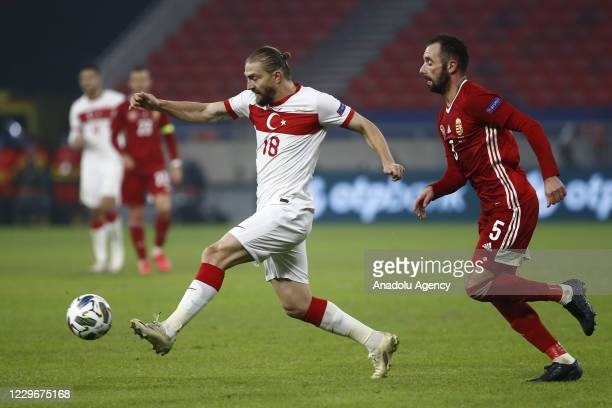 Caner Erkin of Turkey in action against Attila Fiola of Hungary during the UEFA Nations League match between Hungary and Turkey at Puskas Arena in...