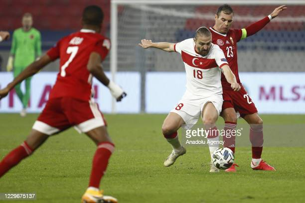 Caner Erkin of Turkey in action against Nemanja Nikolic of Hungary during the UEFA Nations League match between Hungary and Turkey at Puskas Arena in...