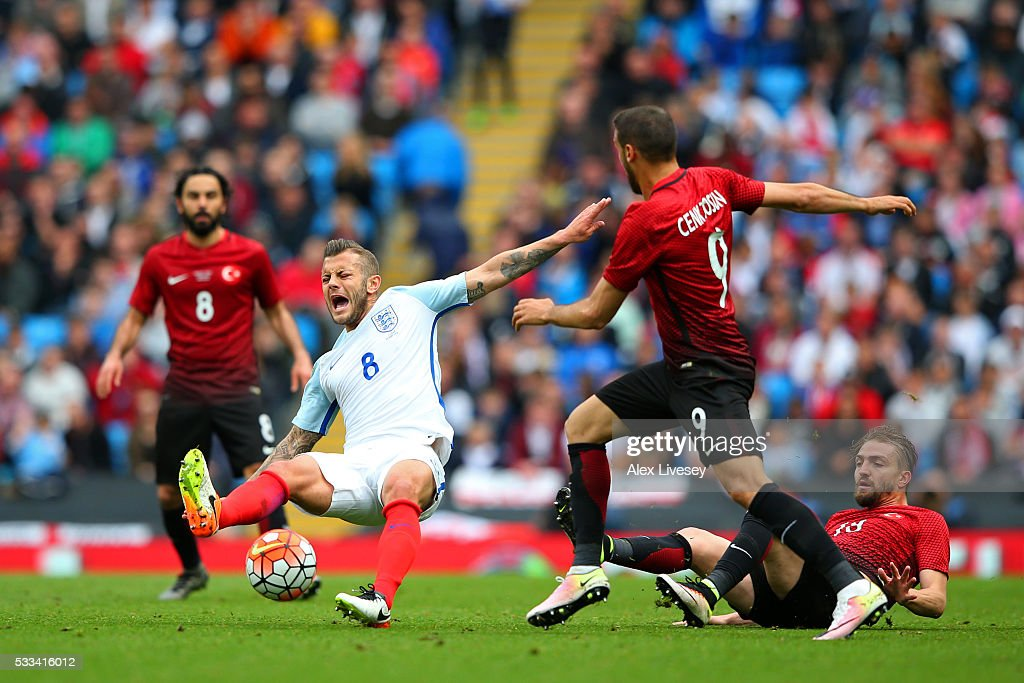 Caner Erkin of Turkey makes a challenge on Jack Wilshere of England during the International Friendly match between England and Turkey at Etihad Stadium on May 22, 2016 in Manchester, England.