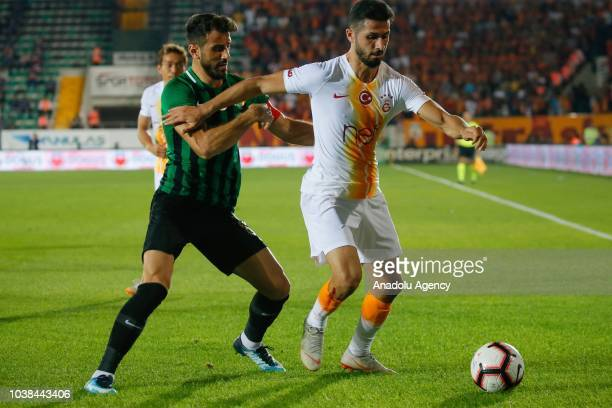 Caner Osmanpasa of Akhisarspor in action against Emre Akbaba of Galatasaray during Turkish Super Lig soccer match between Akhisarspor and Galatasaray...