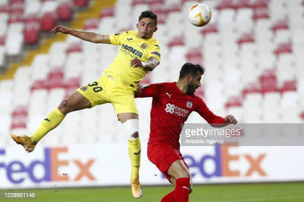 Caner Osmanpasa of Demir Grup Sivasspor in action against Yerimi Pino of Villarreal during UEFA Europa League Group I match between Demir Grup...