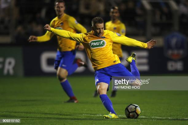 Canet's Pierre Malhieu kicks to score a goal during the French Cup football match between Canet and Caen at the Municipal Stadium in...