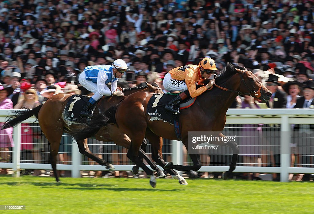 Canford Cliffs ridden by Richard Hughes leads Goldikova ridden by Olivier Peslier to land The Queen Anne Stakes during day one of Royal Ascot at Ascot racecourse on June 14, 2011 in Ascot, England.