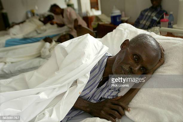 Cange Haiti––Paul Joseph lays in a bed in at Zanmi Lasanta a clinic in rural Cange that serves many patients with AIDS Joseph who has AIDS has been...