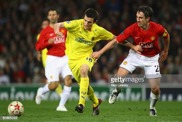 Cani of Villareal battles for the ball with Gary Neville of Manchester United during the UEFA Champions League Group E match between Manchester...