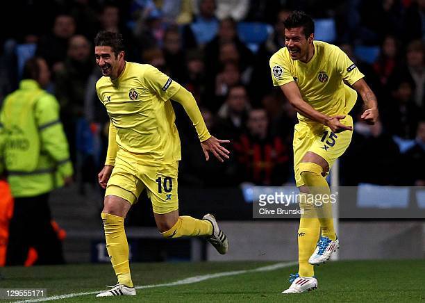 Cani of Villareal celebrates scoring the opening goal with team mate Jose Catala during the UEFA Champions League Group A match between Manchester...