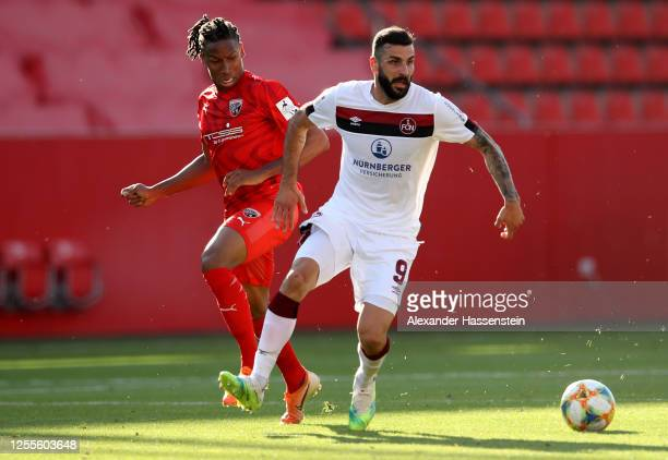 Caniggia Elva of Ingolstadt is challenged by Mikael Ishak of Nuremberg during the 2. Bundesliga playoff second leg match between FC Ingolstadt and 1....
