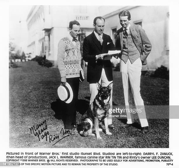Canine film star Rin Tin Tin with Warner Bros head of production Darryl F Zanuck studio executive Jack Warner and Rin Tin Tin's handler Lee Duncan...