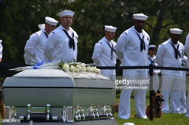 Canine handlers and their dogs stand during the funeral ceremony for Master at Arms 2nd Class Sean Brazas at Arlington National Cemetery Arlington...