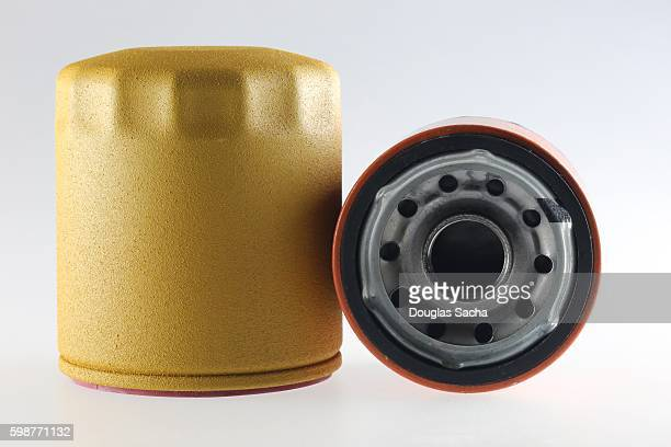 canister oil filter used to remove contaminants from motor oil in an internal-combustion engines - motor oil stock pictures, royalty-free photos & images