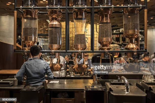 Canisters of coffee beans sit in a rack inside the Starbucks Corp Reserve Roastery store in Shanghai China on Friday May 11 2018 Starbucksis laying...