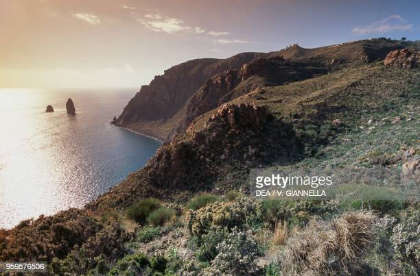 Canna Sea stack at sunset igneous rock formation Filicudi island Lipari or Aeolian islands Sicily Italy