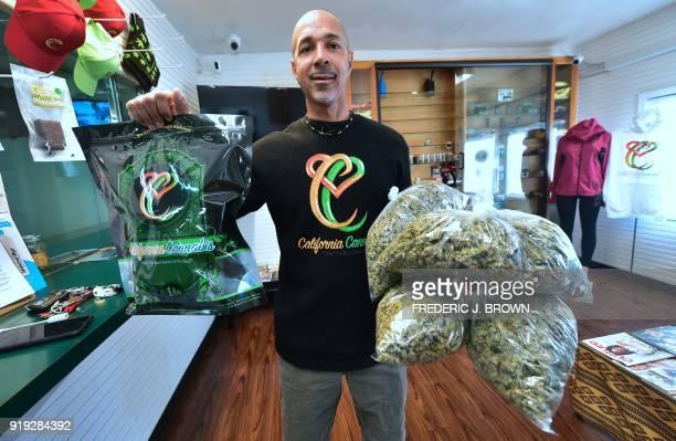 Cannabis entrepreneur Virgil Grant carries bags of medical marijuana at a dispensary he runs in Los Angeles California on February 8 2018 Virgil...