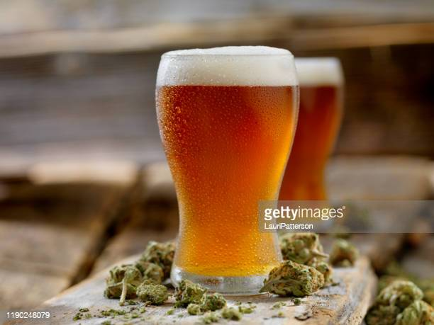 cannabis infused amber ale - ale stock pictures, royalty-free photos & images