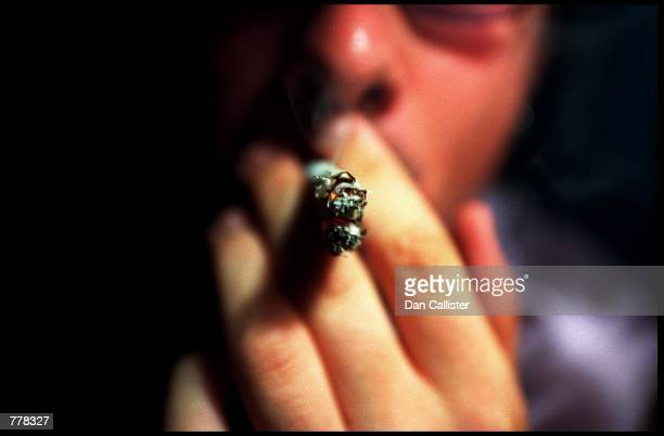 A cannabis joint is smoked at The Los Angeles Cannabis Resource Center September 1 where Cannabis can be legally bought for medicinal purposes if...