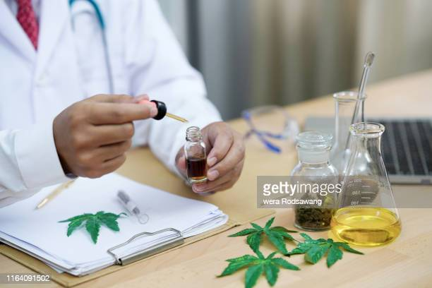 cannabis oil research - cbd oil stock pictures, royalty-free photos & images
