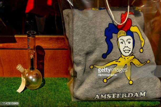 cannabis pipe and sweatshirt in shop window - crack pipe stock pictures, royalty-free photos & images