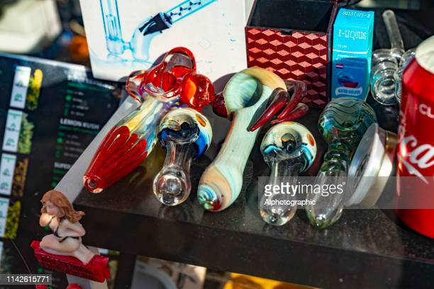 cannabis pipes in shop window - crack pipe stock pictures, royalty-free photos & images