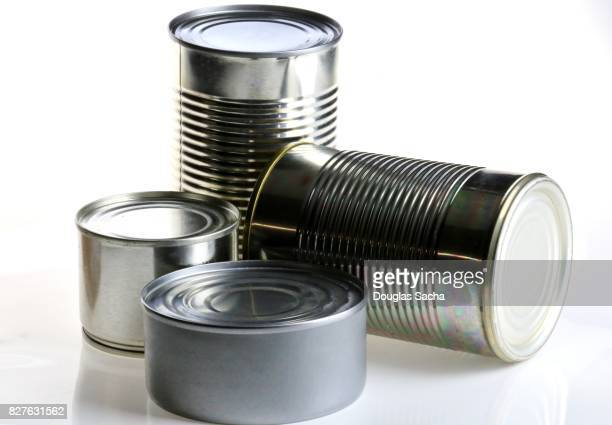 Canned food in various sizes on a white background