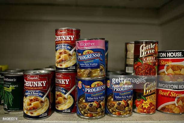 Canned food that will be packed into boxes for needy families is seen on a packing table at the Alameda County Community Food Bank December 18 2008...