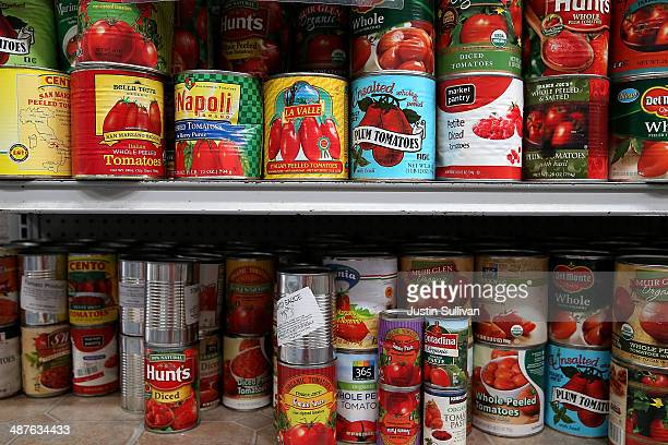 Canned tomatoes line the shelves of a pantry at the SFMarin Food Bank on May 1 2014 in San Francisco California Food banks are bracing for higher...