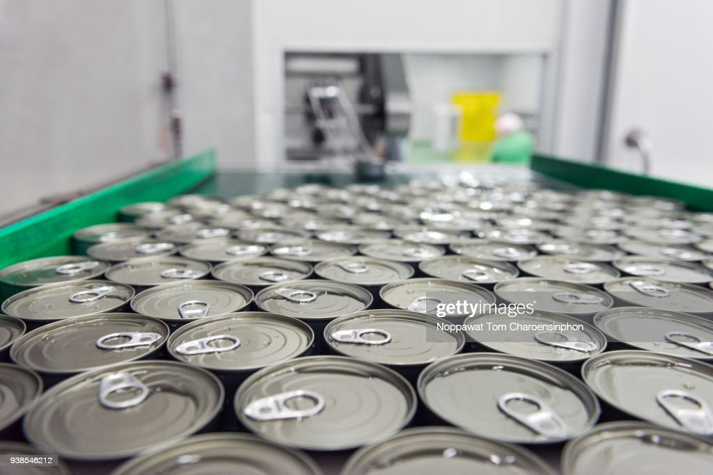 Canned tuna on automatic conveyor belt, Thailand : Stock Photo