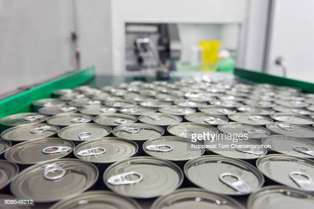 canned tuna on automatic conveyor belt, thailand - canned food stock pictures, royalty-free photos & images