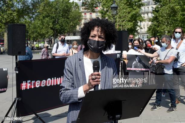 Cannelle Bernard delivers a speech on June 8, 2021 in Paris, during a gathering for her step-brother French journalist Olivier Dubois, kidnapped in...