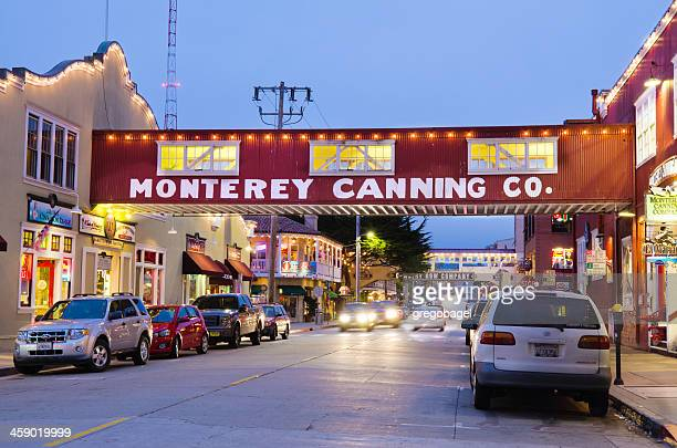 cannery row in monterey, ca at night - city of monterey california stock pictures, royalty-free photos & images