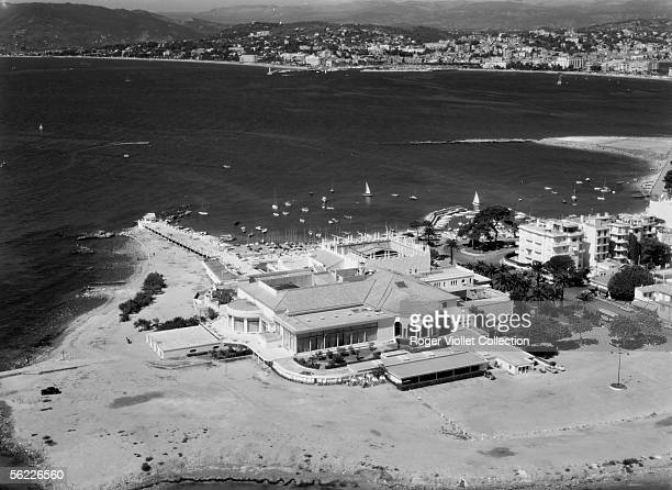 Cannes At the foreground the summer casino Palmbeach At the background the ancient harbour Aerial view