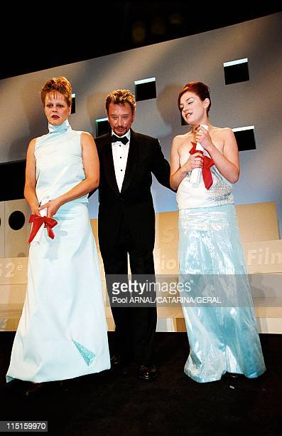 Cannes film festival closing ceremony in Cannes France in May 1999 Johnny Hallyday Emilie Dequenne and Severine Caneele