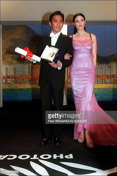 Cannes film festival closing ceremony Prize In Cannes France On May 21 2000Tony Leung ChiuWai and Monica Bellucci