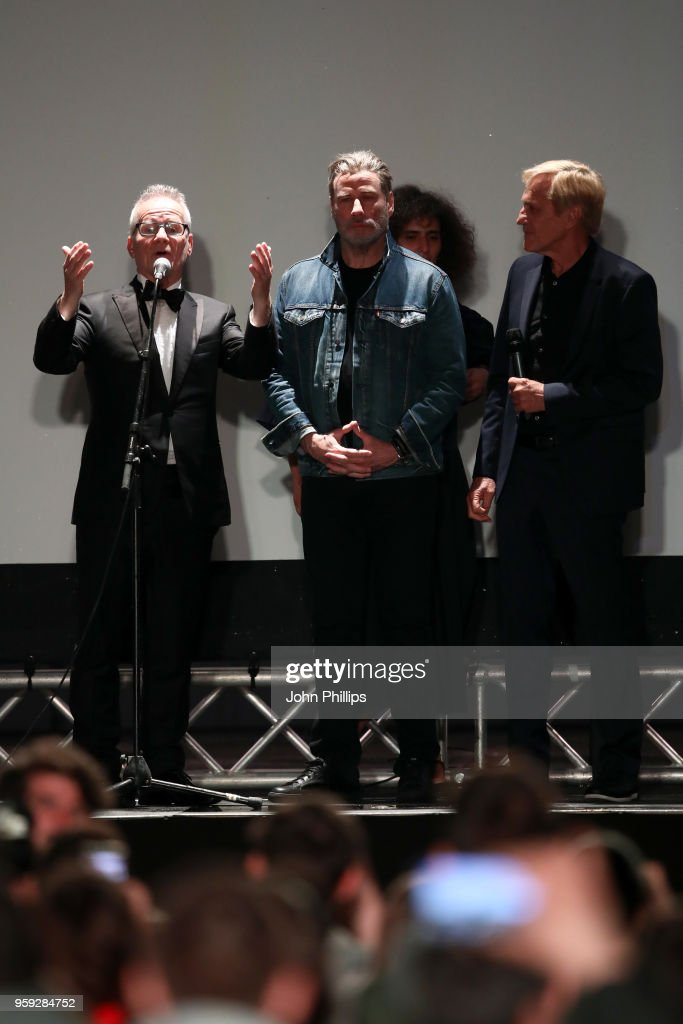 Cannes Film Festival Director Thierry Fremaux, actor John Travolta and director Randall Kleiser speak onstage during the 'Grease' 40th Anniversary Screening during the 71st annual Cannes Film Festival at on May 16, 2018 in Cannes, France.