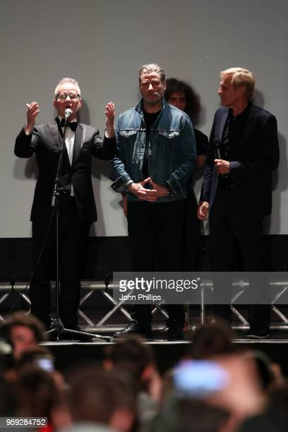 Cannes Film Festival Director Thierry Fremaux actor John Travolta and director Randall Kleiser speak onstage during the 'Grease' 40th Anniversary...