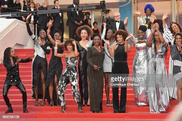 Cannes Film Festival Director Thierry Fremaux and jury member Khadja Nin stand behind Shirley Souagnon Karidja Toure Assa Sylla Sonia Rolland...