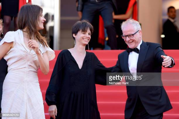 Cannes Film Festival Director Thierry Fremaux dances as musicians play on the red carpet before the screening of 'Capharnaum' during the 71st annual...