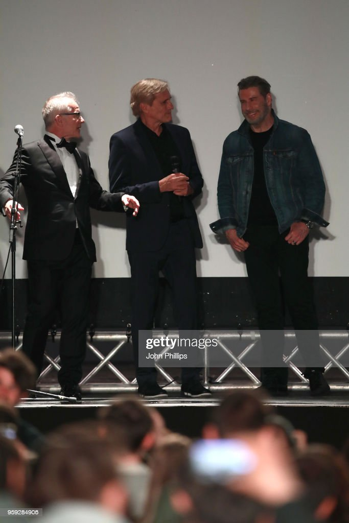 Cannes Film Festival Director Thierry Fremaux, director Randall Kleiser and John Travolta attend the 'Grease' 40th Anniversary Screening during the 71st annual Cannes Film Festival at on May 16, 2018 in Cannes, France.