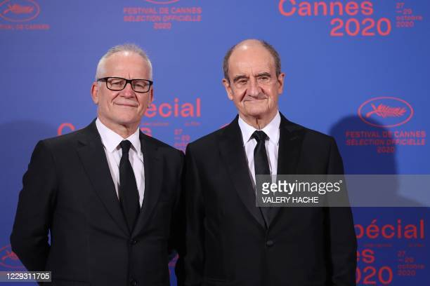 Cannes film festival general delegate Thierry Fremaux and French director of the Cannes film festival Pierre Lescure pose as they arrive at the...