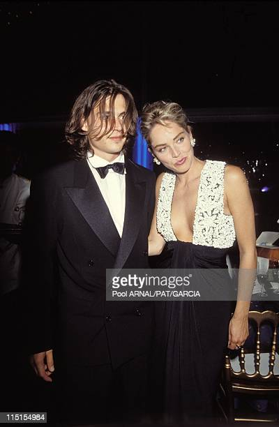 Cannes Film Festival in Cannes France on May 01 1992 Johnny Depp and Sharon Stone arriving at the opening ceremony of Cannes Film Festival