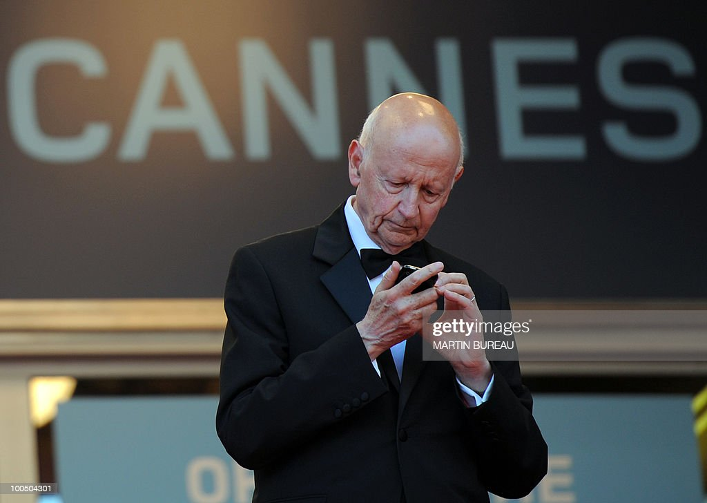 Cannes Film Festival President Gilles Jacob looks at his phone as guests arrive for the screening of 'Utomlyonnye Solntsem 2: Predstoyanie' (The Exodus - Burnt By The Sun 2) presented in competition at the 63rd Cannes Film Festival on May 22, 2010 in Cannes.