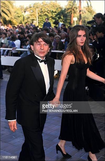 "Cannes Film Festival: stairs of ""Le Pas Suspendu de la Cigogne"" in Cannes, France on May 18, 1991 - Roman Polanski and Emmanuelle Seigner."