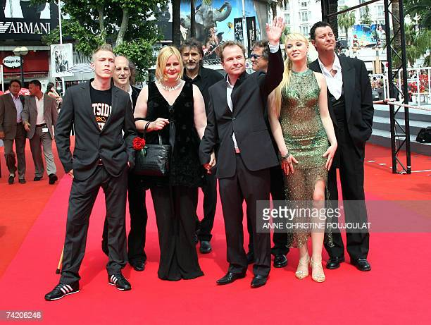 Austrian director Ulrich Seidl waves to the crowd 21 May 2007 as he arrives with Austrian actor Paul Hofmann Ukrainian actress Ekateryna Rak Austrian...