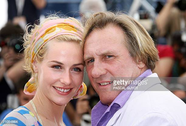 Belgian actress Cecile de France and French actor Gerard Depardieu pose during a photocall for French director Xavier Giannoli's film 'Quand j'etais...