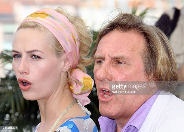 Belgian actress Cecile de France and French actor Gerard Depardieu shout during a photocall for French director Xavier Giannoli's film 'Quand j'etais...