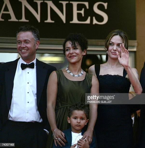 British director Michael Winterbottom French journalist and writer Mariane Pearl and her son Adam and US actress Angelina Jolie pose 21 May 2007 upon...