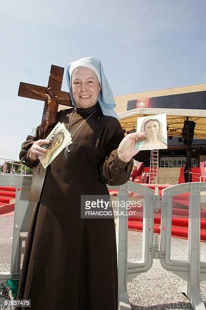 British Sister Mary Michael from the Lady's sister of peace and mercy, holds a picture of the Virgin Mary as she protests against US director Ron...
