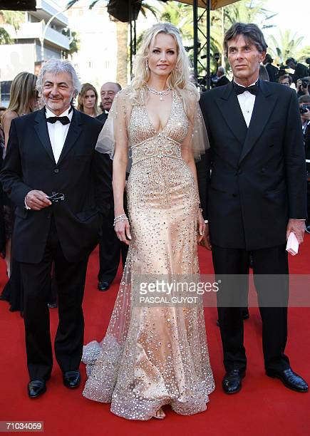 Czech model Adriana Karembeu arrives with French hairdresser Jacques Dessange at the Festival Palace to attend the premiere of US director Sofia...
