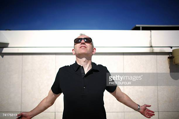 Dutch graphic artist/director Anton Corbijn poses during an interview with AFP for his film 'Control' on the roof of the Noga Hilton hotel in Cannes...