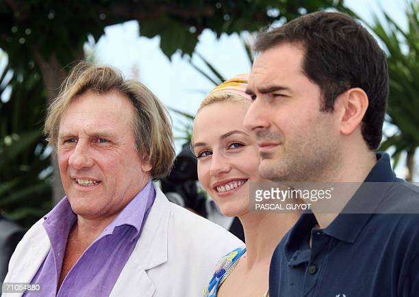 French actor Gerard Depardieu Belgian actress Cecile de France and French director Xavier Giannoli pose during a photocall for their film 'Quand...
